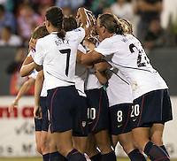 USA players celebrate during the semifinal match of CONCACAF Women's World Cup Qualifying tournament held at Estadio Quintana Roo in Cancun, Mexico. Mexico 2, USA 1.