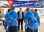 Spartak Trnava v St Johnstone...06.08.14  Europa League Qualifier 3rd Round<br /> Manager Tommy Wright talks to his players as they wait for luggage at Bratislava Airport<br /> Picture by Graeme Hart.<br /> Copyright Perthshire Picture Agency<br /> Tel: 01738 623350  Mobile: 07990 594431