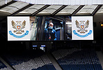 St Johnstone v Hibs…22.05.21  Scottish Cup Final Hampden Park<br />Chris Kane arrives at Hampden Park on he coach seen on the giant scoreboard in an empty Hampden Park<br />Picture by Graeme Hart.<br />Copyright Perthshire Picture Agency<br />Tel: 01738 623350  Mobile: 07990 594431