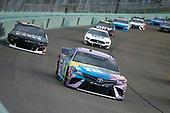 HOMESTEAD, FLORIDA - JUNE 14: Kyle Busch, driver of the #18 M&M's Messages Toyota, leads a pack of cars during the NASCAR Cup Series Dixie Vodka 400 at Homestead-Miami Speedway on June 14, 2020 in Homestead, Florida. (Photo by Michael Reaves/Getty Images)