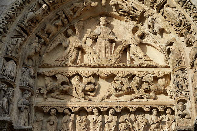 West Facade, Left Portal - General View of Tympanum c. 1145. Cathedral of Chartres, France . The tympanum of the left door shows the Ascension or the Second Coming. Christ (crossed halo) stands on a cloud, supported by two angels. Below are four angels (descending from the clouds?) Some of them have their mouths open (singing?). On the lintel below are ten seated men holding books or scrolls and looking upward (apostles?). On the archivolts are the Signs of the Zodiac and the Labors of the Months.. A UNESCO World Heritage Site.
