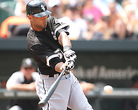 Alex Rios #51 of the Chicago White Sox makes contact during a MLB game against the Baltimore Orioles at Camden Yards, on August 8 2010, in Baltimore, Maryland.