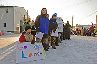 Fans wait for musher Lance Mackey on Front Street in Nome at the start of the 2008 All Alaska Sweepstakes 100 year commemorative sled dog race.