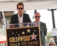 Michael Keaton + son Sean Douglas @ this Walk of Fame ceremony held @ 6931 Hollywood blvd. July 28, 2016