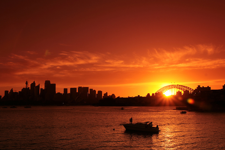 Sunset in Sydney Harbour at new years eve 2008 - a photo by Axel Bluhme. Please see more at axelbluhme.com