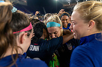 ORLANDO, FL - MARCH 05: Julie Ertz #8 of the United States celebrates her 100th cap with Crystal Dunn #19 during a game between England and USWNT at Exploria Stadium on March 05, 2020 in Orlando, Florida.