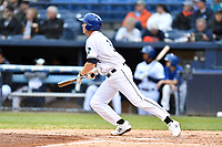 Asheville Tourists first baseman Grant Lavigne (34) swings at a pitch during a game against the Augusta GreenJackets at McCormick Field on April 5, 2019 in Asheville, North Carolina. The  Tourists defeated the GreenJackets 5-0. (Tony Farlow/Four Seam Images)