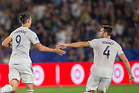 CARSON, CA - SEPTEMBER 15: Zlatan Ibrahimovic #9 and Dave Romney #4 of the Los Angeles Galaxy celebrate a goal during a game between Sporting Kansas City and Los Angeles Galaxy at Dignity Health Sports Park on September 15, 2019 in Carson, California.