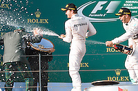 March 15, 2015: Lewis Hamilton (GBR) #44 (1st) and Nico Rosberg (DEU) #6 (2nd) spray champagne at Jackie Stewart on the podium at the 2015 Australian Formula One Grand Prix at Albert Park, Melbourne, Australia. Photo Sydney Low