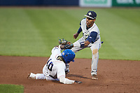 Bryan Ramos (10) of the Kannapolis Cannon Ballers slides into second base ahead of the tag by Columbia Fireflies shortstop Maikel Garcia (8) at Atrium Health Ballpark on May 18, 2021 in Kannapolis, North Carolina. (Brian Westerholt/Four Seam Images)
