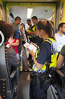 Switzerland. Canton Ticino. Three police officers from TPO (Transport Police) Two policemen and a policewoman control the train tickets' validity of passengers travelling on a TILO train between Lugano and Chiasso. The policewoman gives a fine to a passenger travelling without ticket while the other two policemen check the identity of a Romanian Romani man travelling without ticket. On the next station, the man was expelled from the train. The Romani (also spelled Romany, Roma, Roms or Rroms, are a traditionally nomadic ethnic group. TPO (Transport Police) is the Swiss Federal Railways Police. Swiss Federal Railways (German: Schweizerische Bundesbahnen (SBB), French: Chemins de fer fédéraux suisses (CFF), Italian: Ferrovie federali svizzere (FFS)) is the national railway company of Switzerland. It is usually referred to by the initials of its German, French and Italian names, as SBB CFF FFS. TILO (Treni Regionali Ticino Lombardia) creates efficient train connections between the towns in the canton Ticino.12.06.2017 © 2017 Didier Ruef