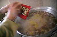 Making asure in Turkey: grating orange peel