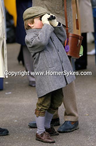 Like father like son, a young boy the Grand National horse race  Aintree  Lancashire England 1980s UK