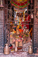 Nepal, Patan.  Hindu Priest at an Altar Featuring Sheshnag, the Divine Five-headed Serpent in Hindu Mythology.