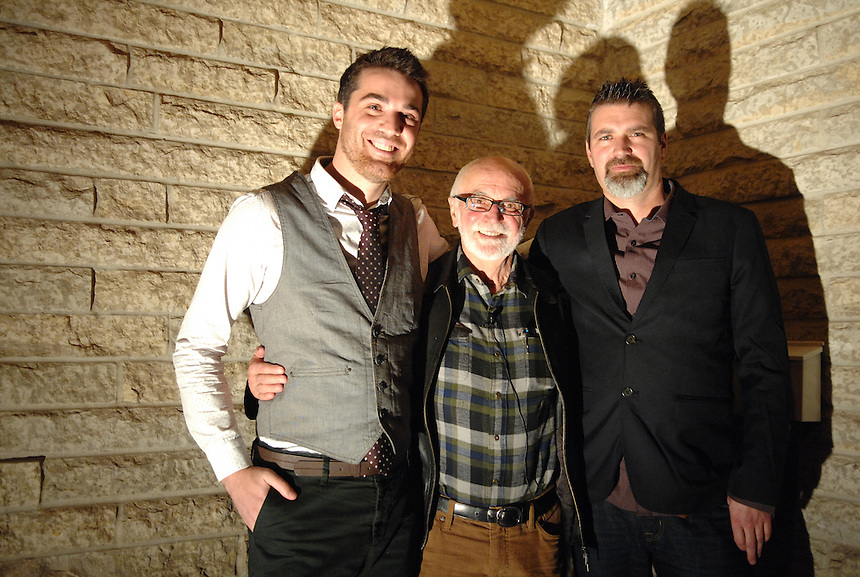 Joe Fafard, centre, is flanked by son Joël Fafard, right, and guitarist Joel Schwartz, left, during at the opening of A Tune to Art: Sculpture and Song at the Slate Fine Art Gallery in Regina. The event showcased new works by the Canadian sculptor and a live performance by the younger Fafard and Schwartz. MARK TAYLOR FOR THE GLOBE AND MAIL.
