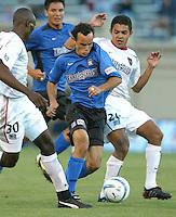 8 May 2004:  Earthquakes Landon Donovan dribbles the ball through MetroStars Defenders Amado Guevara and Tenywa Bonseu at Spartan Stadium in San Jose, California.   Earthquakes and MetroStars are tied at 5-5..Mandatory Credit: Michael Pimentel/ISI