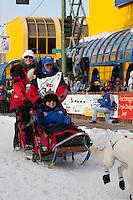 Musher Paul Gebhardt and Iditarider Julieanne Brackin.leave the 2011 Iditarod ceremonial start line in downtown Anchorage, Alaska