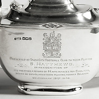 """BNPS.co.uk (01202) 558833. <br /> Pic: DeepSouthMedia/BNPS<br /> <br /> Pictured: The teapot is inscribed """"Presented by Stoke City Football Club to their player S Matthews in recognition of his creating a record of 44 appearances for England which he established when playing against Belgium on January 19th 1946.""""<br /> <br /> A silver tea service presented by Stoke City FC to their player Stanley Matthews that marked his record 44th cap for England is being sold. <br /> <br /> Nicknamed 'the wizard of the dribble', Matthews made his record international appearance in the 2-0 win against Belgium in January 1946.<br /> <br /> He was presented with the service shortly before he moved to Blackpool after what the press described as a 'bust-up' with Stoke's manager Bob McGory."""