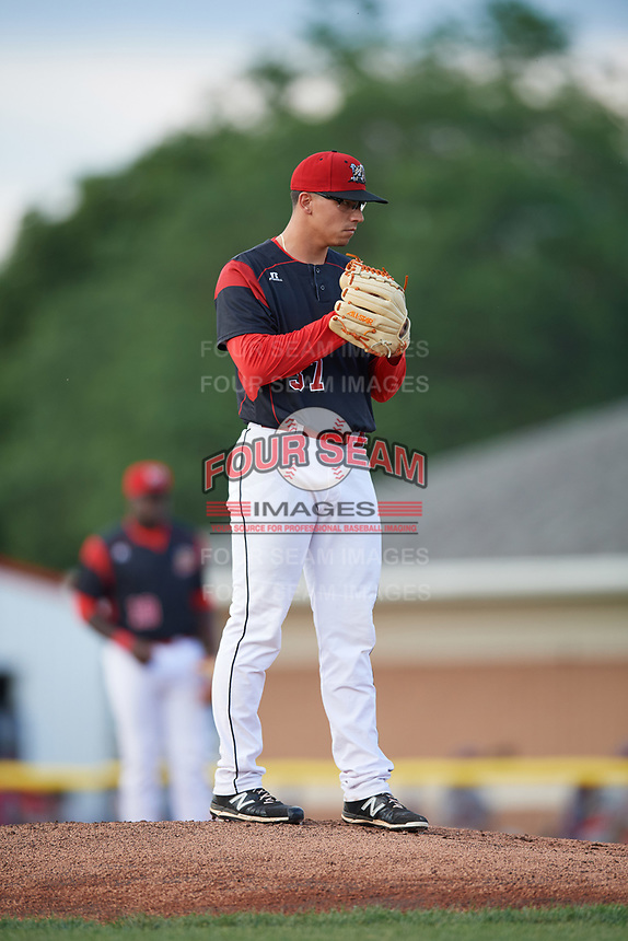 Batavia Muckdogs starting pitcher Alejandro Mateo (37) looks in for the sign during a game against the Auburn Doubledays on June 19, 2017 at Dwyer Stadium in Batavia, New York.  Batavia defeated Auburn 8-2 in both teams opening game of the season.  (Mike Janes/Four Seam Images)