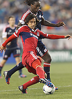 Chicago Fire substitute midfielder Rafael Robayo (88) dribbles as New England Revolution midfielder Shalrie Joseph (21) defends. In a Major League Soccer (MLS) match, the New England Revolution defeated Chicago Fire, 2-0, at Gillette Stadium on June 2, 2012.