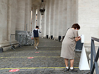 A woman cleans her hands before entering in St. Peter's Square and Basilica on May 18, 2020 at The Vatican  in the day of the reopening of St. Peter's Basilica. Italy is slowly lifting sanitary restrictions after a two-month coronavirus lockdown.<br /> UPDATE IMAGES PRESS/Isabella Bonotto<br /> <br /> STRICTLY ONLY FOR EDITORIAL USE