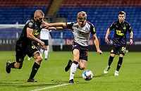 Bolton Wanderers' Ronan Darcy (centre) breaks away from Newcastle United U21's Jude Swailes<br /> <br /> Photographer Andrew Kearns/CameraSport<br /> <br /> EFL Papa John's Trophy - Northern Section - Group C - Bolton Wanderers v Newcastle United U21 - Tuesday 17th November 2020 - University of Bolton Stadium - Bolton<br />  <br /> World Copyright © 2020 CameraSport. All rights reserved. 43 Linden Ave. Countesthorpe. Leicester. England. LE8 5PG - Tel: +44 (0) 116 277 4147 - admin@camerasport.com - www.camerasport.com