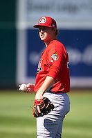 Peoria Chiefs pitcher Matt Pearce (37) throws in the outfield before a game against the Lansing Lugnuts on June 6, 2015 at Cooley Law School Stadium in Lansing, Michigan.  Lansing defeated Peoria 6-2.  (Mike Janes/Four Seam Images)