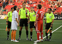 29 July 2009: Puerto Rico Islanders midfielder Noah Delgado #5 and Toronto FC midfielder Jim Brennan #11 during the coin toss of a CONCACAF game at BMO Field in Toronto between the Puerto Rico Islanders and Toronto FC..The Puerto Rico Islanders won 1-0..