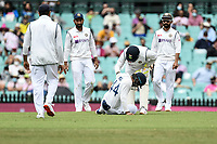 8th January 2021; Sydney Cricket Ground, Sydney, New South Wales, Australia; International Test Cricket, Third Test Day Two, Australia versus India; Hanuma Vihari of India is attended to by Manish Pandey of India after getting hit on the leg