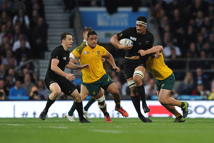 Jerome Kaino of New Zealand breaks through the tackle of Michael Hooper of Australia during the Rugby World Cup Final between New Zealand and Australia - 31/10/2015 - Twickenham Stadium, London<br /> Mandatory Credit: Rob Munro/Stewart Communications