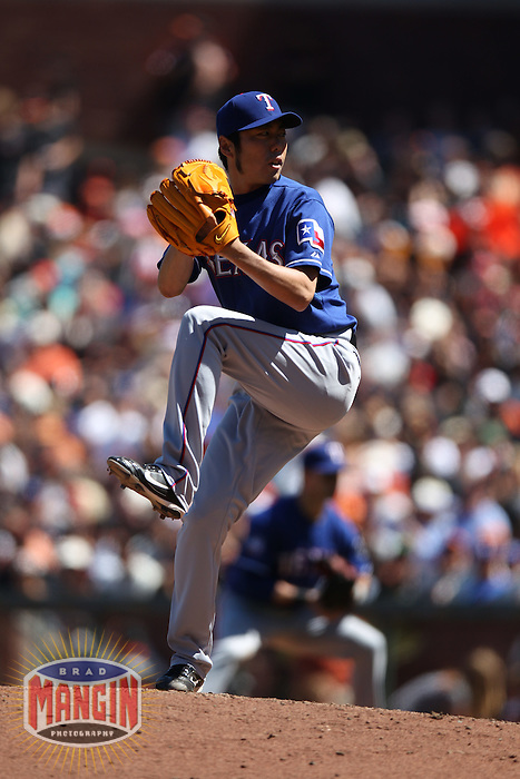 SAN FRANCISCO, CA - JUNE 9:  Koji Uehara #19 of the Texas Rangers pitches against the San Francisco Giants during the game at AT&T Park on Saturday, June 9, 2012 in San Francisco, California. Photo by Brad Mangin