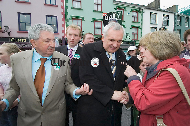 The taoiseach Bertie Ahern  has the finger pointed at him by a woman in Kilrush. Looking on are election candidates Brendan Daly aned Timmy Dooley. Photograph by John Kelly.