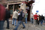 Heart of Midlothian 4 Inverness Caledonian Thistle 1, 26/08/2006. Tynecastle Park, Scottish Premier League. Heart of Midlothian fans making their way to the team's Tynecastle Park home before a Scottish Premier League game against Inverness Caledonian Thistle. Hearts have been in existence since 1874 and are strongly identified with the Gorgie area of Edinburgh where they play. The club was taken over by a Lithuanian multi-millionaire, Vladimir Romanov in early 2005 and finished runners-up in the league and were Scottish Cup winners in 2005-06. The home team won the match 4-1 watched by 15,912 spectators. Photo by Colin McPherson.
