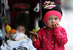 MacKenna Norwood, 2, enjoys a treat at the Road to the Future celebration in downtown Carson City, Nev. on Friday, Oct. 28, 2016. <br />