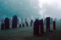 gravestones and fog in a rural graveyard, eerie scene, headstones, mist. New Hampshire.