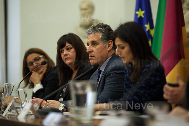 """(From L to R) Romina Lanza, Francesca Scoleri, Nino Di Matteo & Virginia Raggi.<br /> <br /> Rome, 04/04/2018. Today, """"Themis & Metis"""", the Mayor of Rome & the """"Assemblea Capitolina"""" (Elected governing body for political-administrative control of the municipality composed of the mayor and 48 councillors), held a public conference in Campidoglio's Sala Protomoteca called """"Mafia 2.0 - Azioni di contrasto da parte dello Stato"""" (Mafia 2.0 - Enforcement actions by the State), hosted by Nino Di Matteo (Antimafia Magistrate of the city of Palermo & member of the DNA, Anti-mafia & Anti-terrorism National Directorate), Virginia Raggi (Mayor of Rome, Five Star Movement Politician), Marco Travaglio (Editor of """"Il Fatto Quotidiano"""" newspaper), Marcello De Vito (President of the """"Assemblea Capitolina"""", Five Star Movement politician), Francesca Scoleri (President of Themis & Metis), Mauro Vaglio (President of the Lawyers of Rome, Five Star Movement's candidate for the Italian Senate at the 04 March 2018 General Election), Sabrina Delpidio (Lawyer & Vice President of Themis & Metis), Romina Lanza (President of """"Associazione Italiana Giovani Avvocati di Roma"""" – AIGA, Italian Association of the young lawyers of Rome). Unfortunately, Gaetano Saffioti (Italian entrepreneur from Calabria, racket/mafia/'ndrangheta victim and cooperating witness /judicial collaborator who has lived under police protection since 2002 - https://bit.ly/2uOzsKD) and Giuseppe Lombardo (Deputy Prosecutor of Reggio Calabria - https://bit.ly/2uNNM6f) could not attend the event. From the organisers website: <<Infiltrations in Public Administration and Finance, collusion with corrupt politicians and ineffective laws. At what point is the fight against the mafia?>><br /> <br /> For more info please click here: https://bit.ly/2q7CJ2a<br /> <br /> For the video of the event by Radio Radicale please click here: https://bit.ly/2IuMmzA"""