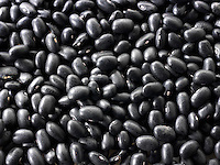 Un-cooked whole Black beans - stock photos