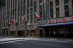 Empty streets and sidewalks are seen in front of Radio City Music Hall in New York, U.S., on Thursday, March 19, 2020. New York state Governor Andrew Cuomo on Thursday ordered businesses to keep 75% of their workforce home as the number of coronavirus cases rises rapidly. Photograph by Michael Nagle/Redux