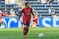 BRIDGEVIEW, IL - JULY 18: Sarah Bouhaddi #12 of the OL Reign plays the ball during a game between OL Reign and Chicago Red Stars at SeatGeek Stadium on July 18, 2021 in Bridgeview, Illinois.