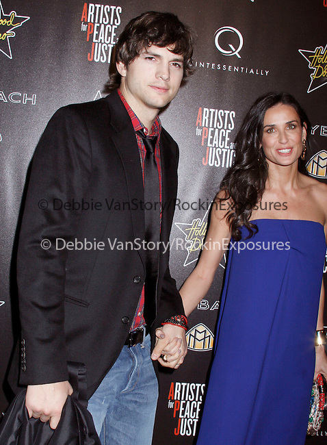 Ashton Kutcher & Demi Moore Kutcher at the 3rd Annual Pre-Oscar Hollywood Domino Gala Benefitting Artists for Peace and Justice at Bar 210 at The Beverly Hills Hotel in Beverly Hills, California on March 04,2010                                                                   Copyright 2010 DVS / RockinExposures