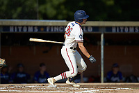 Zach Gelof (26) (UVA) of the High Point-Thomasville HiToms follows through on his swing against the Martinsville Mustangs at Finch Field on July 26, 2020 in Thomasville, NC.  The HiToms defeated the Mustangs 8-5. (Brian Westerholt/Four Seam Images)