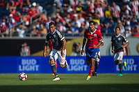 Orlando, Florida - Saturday, June 04, 2016: Paraguayan forward Dario Lezcano (19) dribbles away from Costa Rican midfielder Celso Borges (5) during a Group A Copa America Centenario match between Costa Rica and Paraguay at Camping World Stadium.