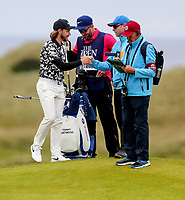 190719 | The 148th Open - Day 2<br /> <br /> Tommy Fleetwood of England gives a Marshall a fist pump after he found his ball on the 16th during the 148th Open Championship at Royal Portrush Golf Club, County Antrim, Northern Ireland. Photo by John Dickson - DICKSONDIGITAL