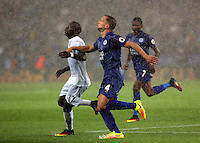 Pictured (L-R): Modou Barrow of Swansea City against Danny Drinkwater of Leicester City Saturday 27 August 2016<br />
