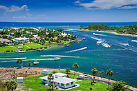 busy weekend boat traffic at Jupiter Inlet, junction of Intercoastal Waterway and Loxahatchee River, Jupiter, Florida, USA, Atlantic Ocean