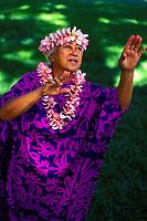 Auntie dancing an auana ( modern) hula with plumeria leis
