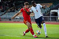 3rd September 2021; Newport, Wales:  Jack Karadogan of Wales tackles Zak Sturage of England during the U18 International Friendly match between Wales and England at Newport Stadium in Newport, Wales.