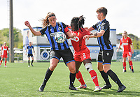 Ellen Martens (2) of Club Brugge pictured in a duel with Fon Welma (2) of Standard  and Isabelle Iliano (18) of Club Brugge during a female soccer game between Club Brugge Dames YLA and Standard Femine de Liege on the seventh matchday in Play-Off 1 of the 2020 - 2021 season of Belgian Scooore Womens Super League , saturday 15 May 2021  in Brugge , Belgium . PHOTO SPORTPIX.BE   SPP   DAVID CATRY