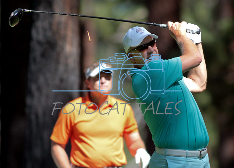 John Elway takes a shot during practice rounds at the American Century Championship golf tournament at Edgewood Tahoe at Stateline, Nev., on Wednesday, July 18, 2012..Photo by Cathleen Allison