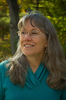 Author Tinney Heath enjoys the autumn sunshine behind the home shared with her husband in Middleton, Wisconsin.